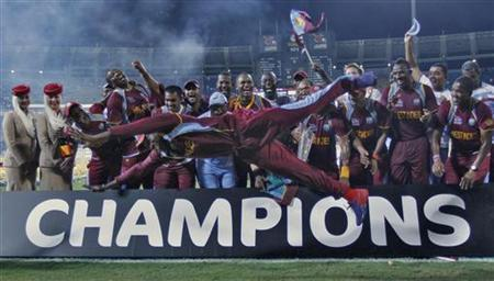 West Indies' Chris Gayle jumps as his teammates watch after winning the World Twenty20 final cricket match against Sri Lanka in Colombo October 7, 2012. REUTERS/Dinuka Liyanawatte/Files