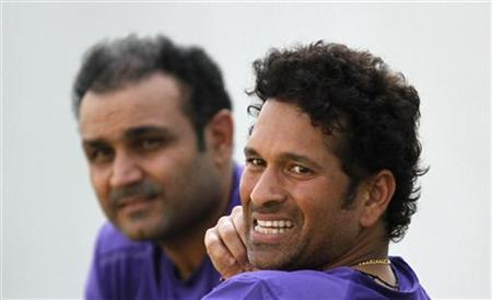 Sachin Tendulkar (R) and Virender Sehwag watch during a cricket practice session in Ahmedabad November 13, 2012. REUTERS/Amit Dave/Files
