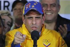 Miranda state Governor Henrique Capriles speaks during a news conference after being re-elected during Venezuela's regional elections in Caracas December 16, 2012. REUTERS/Carlos Garcia Rawlins