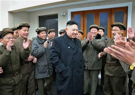 North Korean leader Kim Jong-Un (C) celebrates with scientists and technicians after the launch of the Unha-3 (Milky Way 3) rocket carrying the second version of the Kwangmyongsong-3 satellite at the West Sea Satellite Launch Site in Cholsan county, North Pyongan province, in this undated picture released by the North's KCNA news agency December 15, 2012. REUTERS/KCNA