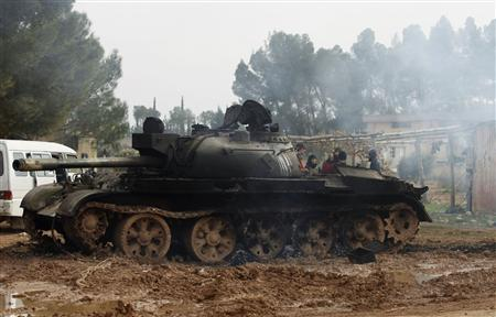 A damaged tank is seen after Free Syrian Army fighters captured the Military Infantry School following heavy clashes with forces loyal to President Bashar al-Assad in Aleppo December 16, 2012. REUTERS/ Zain Karam