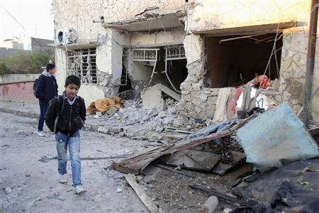 Students inspect a damaged house after a bomb attack in Kirkuk, 250 km (155 miles) north of Baghdad December 17, 2012. REUTERS/Ako Rasheed