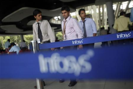 Employees of Indian software company Infosys walk past Infosys logos at their campus in the Electronic City area in Bangalore September 4, 2012. REUTERS/Vivek Prakash