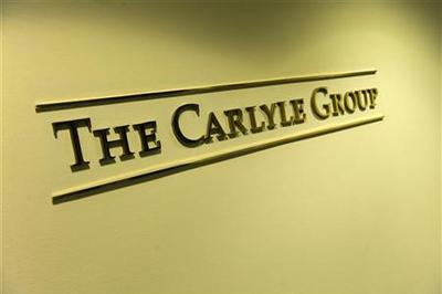 Exclusive: Carlyle risks lower profit on TCW deal