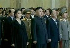 Ri Sol-ju (L), the wife of North Korean leader Kim Jong-un (2nd L), is seen during the inaugural ceremony of the Kumsusan Palace Of The Sun in Pyongyang wearing a black Korean traditional dress and appearing to be heavily pregnant, as they attend the ceremony on the first anniversary of Kim Jong-il's death, in this still image taken from video December 17, 2012. REUTERS/KRT via Reuters TV