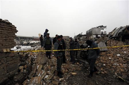 Afghan policemen stand at the site of a blast in Kabul December 17, 2012. REUTERS/Mohammad Ismail