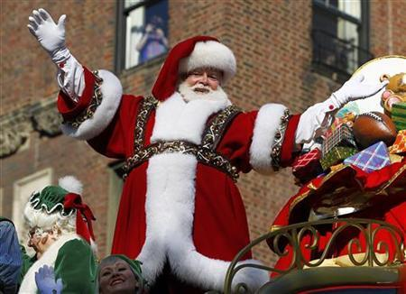 Santa Claus rides on his sleigh down Central Park West during the 86th Macy's Thanksgiving Day Parade in New York November 22, 2012. REUTERS/Gary Hershorn