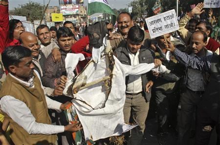 Uttar Pradesh state government employees burn an effigy outside the Bharatiya Janata Party (BJP) office during a protest against caste-based quotas for government job promotions in the northern Indian city of Lucknow December 17, 2012. REUTERS/Pawan Kumar