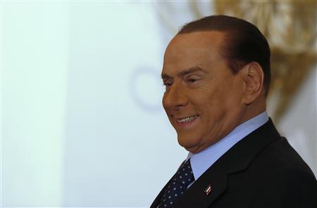 Former Italian Prime Minister Silvio Berlusconi arrives to attend the book launch of his friend, TV presenter Bruno Vespa, in Rome December 12, 2012. REUTERS/Tony Gentile