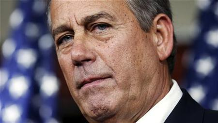 U.S. House Speaker John Boehner (R-OH) listens to a question while speaking with reporters in the Capitol in Washington December 13, 2012. REUTERS/Kevin Lamarque