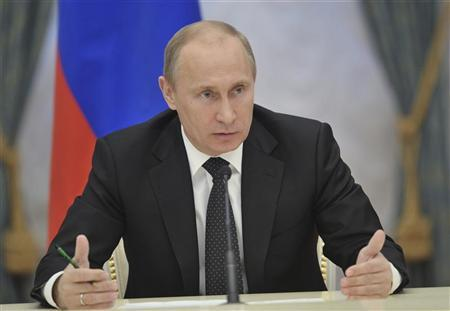 Russian President Vladimir Putin gestures during a government meeting in Moscow December 13, 2012. REUTERS/Alexei Nikolsky/RIA Novosti/Kremlin