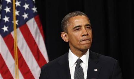 U.S. President Barack Obama looks down as he walks from the rostrum after speaking at a vigil held at Newtown High School for families of victims of the Sandy Hook Elementary School shooting in Newtown, Connecticut December 16, 2012. REUTERS/Kevin Lamarque