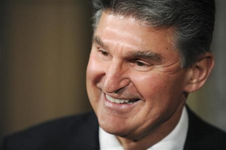 Senator Joe Manchin (D-WV) smiles after being ceremonially sworn in at the US Capitol in Washington, November 15, 2010. REUTERS/Jonathan Ernst
