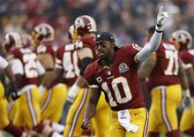 Washington Redskins starting quarterback Robert Griffin III waves to the crowd during pre-game introductions before playing the Baltimore Ravens in their NFL football game in Landover, Maryland December 9, 2012. REUTERS/Gary Cameron