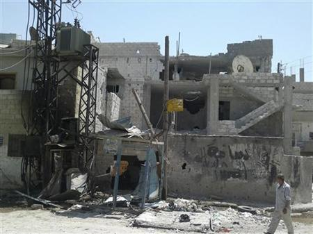 Damaged buildings are seen at the Deraa Palestinian refugee camp August 2, 2012. Picture taken August 2, 2012. REUTERS/Shaam News Network/Handout