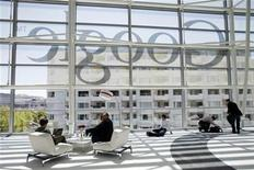 Attendees sits in front of a Google logo during Google I/O Conference at Moscone Center in San Francisco, California June 28, 2012. REUTERS/Stephen Lam