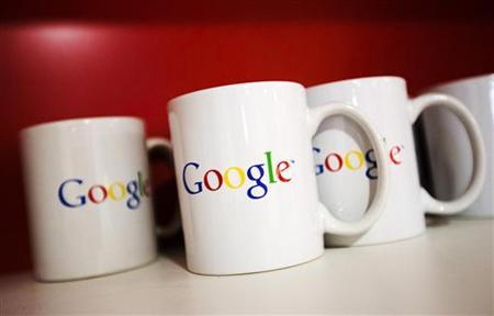 Coffee cups with Google logos are seen at the Google office in Toronto, November 13, 2012. REUTERS/Mark Blinc/Files