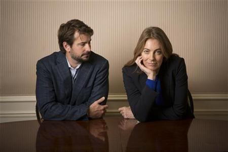 Screenwriter Mark Boal and Director Kathryn Bigelow pose for photos for their film 'Zero Dark Thirty' in New York December 4, 2012. REUTERS/Andrew Kelly