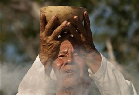 A man takes part in a traditional spiritual ceremony during the Mayan Culture Festival in Merida December 15, 2012. REUTERS/Francisco Martin
