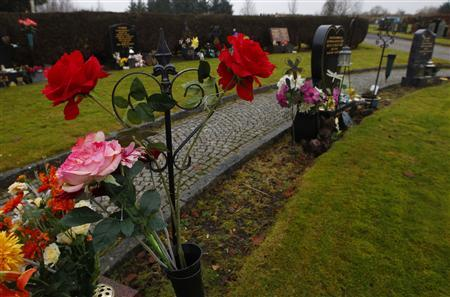 Fresh flowers are seen in the dedicated area for the victims for the 1996 Dunblane Primary School shooting in Dunblane cemetery, Scotland December 17, 2012. REUTERS/David Moir