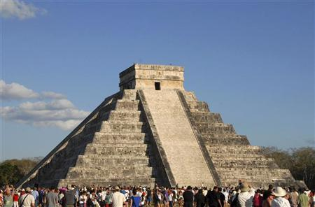 Tourists gather underneath the pyramid of Chichen Itza in Merida in the southern Mexican state of Yucatan March 20, 2012. REUTERS/Francisco Marin