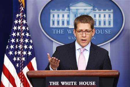 White House Press Secretary Jay Carney answers questions from reporters during a media briefing at the White House in Washington December 17, 2012. REUTERS/Kevin Lamarque