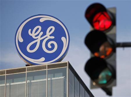 The GE logo is seen behind a traffic light in Prague in this file photo from May 29, 2012. REUTERS/David W Cerny/Files
