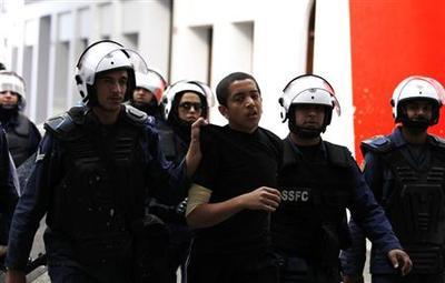 Bahrain breaks up protests, arrests campaigner:...