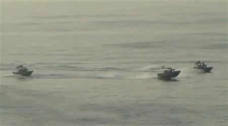 Small Iranian military motorboats travel near the USS New Orleans in the Strait of Hormuz in this still image taken from January 6, 2012 video footage. REUTERS/U.S. Department of Defense/Handout