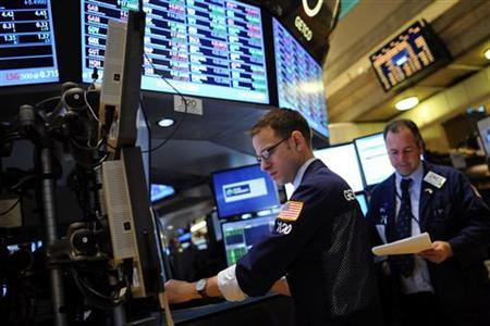 Traders work on the floor of the New York Stock Exchange in New York, November 30, 2012. REUTERS/Keith Bedford/Files