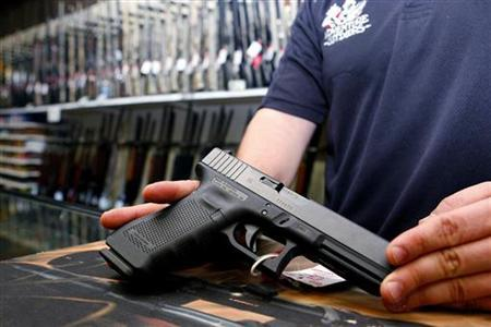 A Glock handgun available in a raffle promotion is shown at Adventures Outdoors in Smyrna, Georgia, October 25, 2012. REUTERS/Tami Chappell