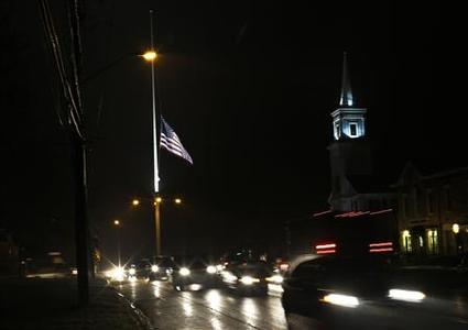A flag is seen at half mast along Main Street in Newtown, Connecticut December 17, 2012. REUTERS/Shannon Stapleton