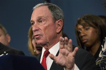 New York City Mayor Michael Bloomberg (C), along with survivors and family members of gun violence victims, addresses the media as part of the Mayors Against Illegal Guns group, to announce the release of 34 ''I Demand a Plan'' videos in New York December 17, 2012. The videos tell stories of Americans whose lives have been changed forever because of gun violence. Bloomberg has upped his stance on the issue since the December 14 Sandy Hook Elementary School shooting massacre in Newtown, Connecticut. REUTERS/Andrew Kelly