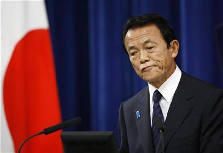 Japan's then Prime Minister Taro Aso reacts during his final news conference as premier at his official residence in Tokyo September 16, 2009. REUTERS/Yuriko Nakao/Files