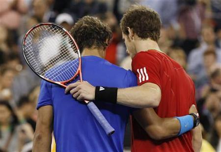 Rafael Nadal of Spain (L) is congratulated by Andy Murray of Britain after Nadal won their semi-final match at the U.S. Open tennis tournament in New York, September 10, 2011. REUTERS/Shannon Stapleton/Files