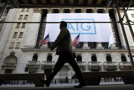 A banner for American International Group Inc (AIG) hangs on the facade of the New York Stock Exchange, Ocotber 16, 2012. REUTERS/Brendan McDermid/Files