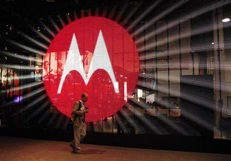 A man walks by a video display at the Motorola booth on the second day of the Consumer Electronics Show (CES) in Las Vegas January 7, 2011. REUTERS/Rick Wilking/Files