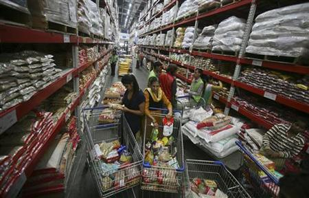 Customers shop inside a Best Price Modern Wholesale store, a joint venture of Wal-Mart Stores Inc and Bharti Enterprises, at Zirakpur in Punjab November 24, 2012. REUTERS/Ajay Verma/Files