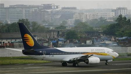 A Jet Airways aircraft waits for take off on the tarmac at the airport in Mumbai September 13, 2009. REUTERS/Punit Paranjpe/Files