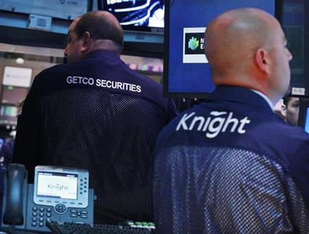 A Getco Securities trader works inside a Knight Capital kiosk on the floor of the New York Stock Exchange, August 6, 2012. REUTERS/Brendan McDermid