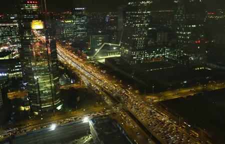Vehicles drive on the 3rd Ring Road through Beijing's central business district, December 17, 2012. REUTERS/Jason Lee