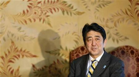Japan's conservative Liberal Democratic Party's (LDP) leader and next Prime Minister Shinzo Abe attends a meeting with New Komeito's party leader Natsuo Yamaguchi at the Parliament in Tokyo December 18, 2012. Abe said on Tuesday that he has asked Bank of Japan Governor Masaaki Shirakawa to consider establishing a 2 percent inflation goal. REUTERS/Toru Hanai (JAPAN - Tags: BUSINESS POLITICS)