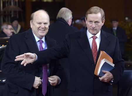 Ireland's Prime Minister Enda Kenny (R) and Finance Minister Michael Noonan arrive at a European Union leaders summit in Brussels December 13, 2012. European governments reached a landmark deal on Thursday that gives the European Central Bank new powers to supervise banks, boosting confidence in the single currency bloc as it enters the fourth year of its debt crisis. REUTERS/Eric Vidal (BELGIUM - Tags: POLITICS BUSINESS)