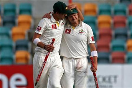 Australia's Peter Siddle (R) and Mitchell Starc celebrate after they defeated Sri Lanka on the fifth day's play in their first cricket test at Bellerive Oval in Hobart December 18, 2012. REUTERS/David Gray