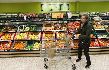 A customer shops at a Tesco shop in Bishop's Stortford, southern England November 26, 2012. REUTERS/Suzanne Plunkett