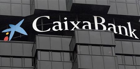 Caixabank's logo is seen on top of the company's headquarters in Barcelona, October 26, 2012. REUTERS/Albert Gea