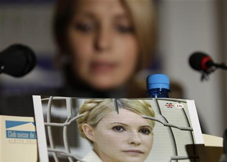 A portait of jailed former Ukrainian prime minister Yulia Tymoshenko is displayed in front of her daughter Yevgenia during a news conference at the Geneva Press Club in Geneva October 24, 2012. REUTERS/Denis Balibouse