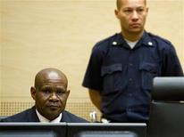 Congolese warlord Ngudjolo Chui (L) sits in the courtroom during his trial at the International Criminal Court (ICC) in The Hague December 18, 2012. REUTERS/Robin van Lonkhuijsen/Pool