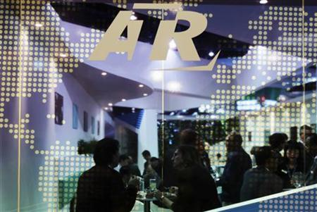 Visitors and staff chat at the ATR pavilion at the Singapore Airshow in Singapore February 16, 2012. REUTERS/Tim Chong