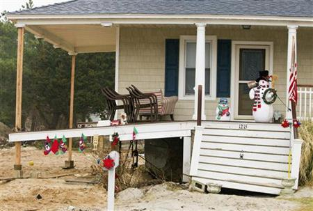 Holiday decorations are seen on the front porch of a damaged home on Bay Avenue in Mantoloking, New Jersey, December 16, 2012, as recovery efforts continue in this town six weeks after Hurricane Sandy hit. REUTERS/Tom Mihalek